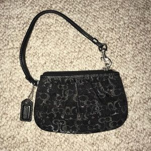 Black and silver coach wristlet